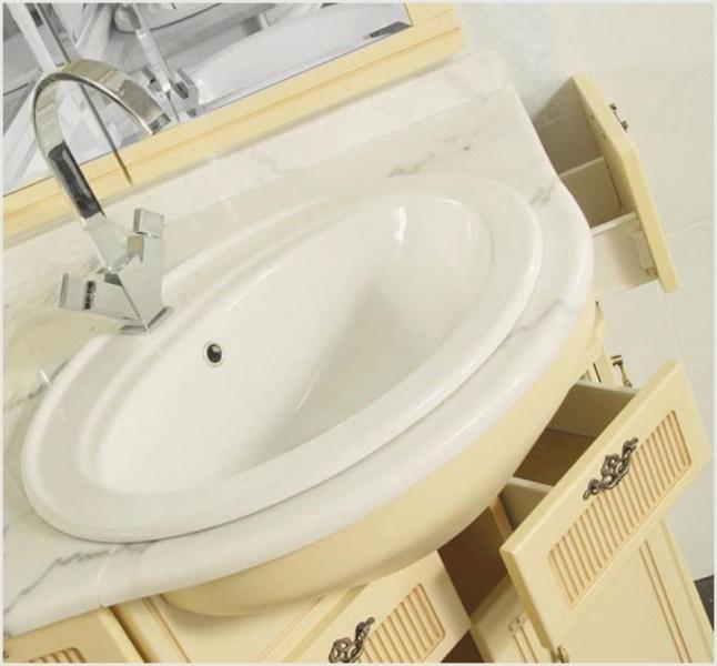 Угловая раковина — для очень маленькой ванной